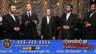 Comedian MODI introducing the SHIRA CHOIR at Chabad Telethon