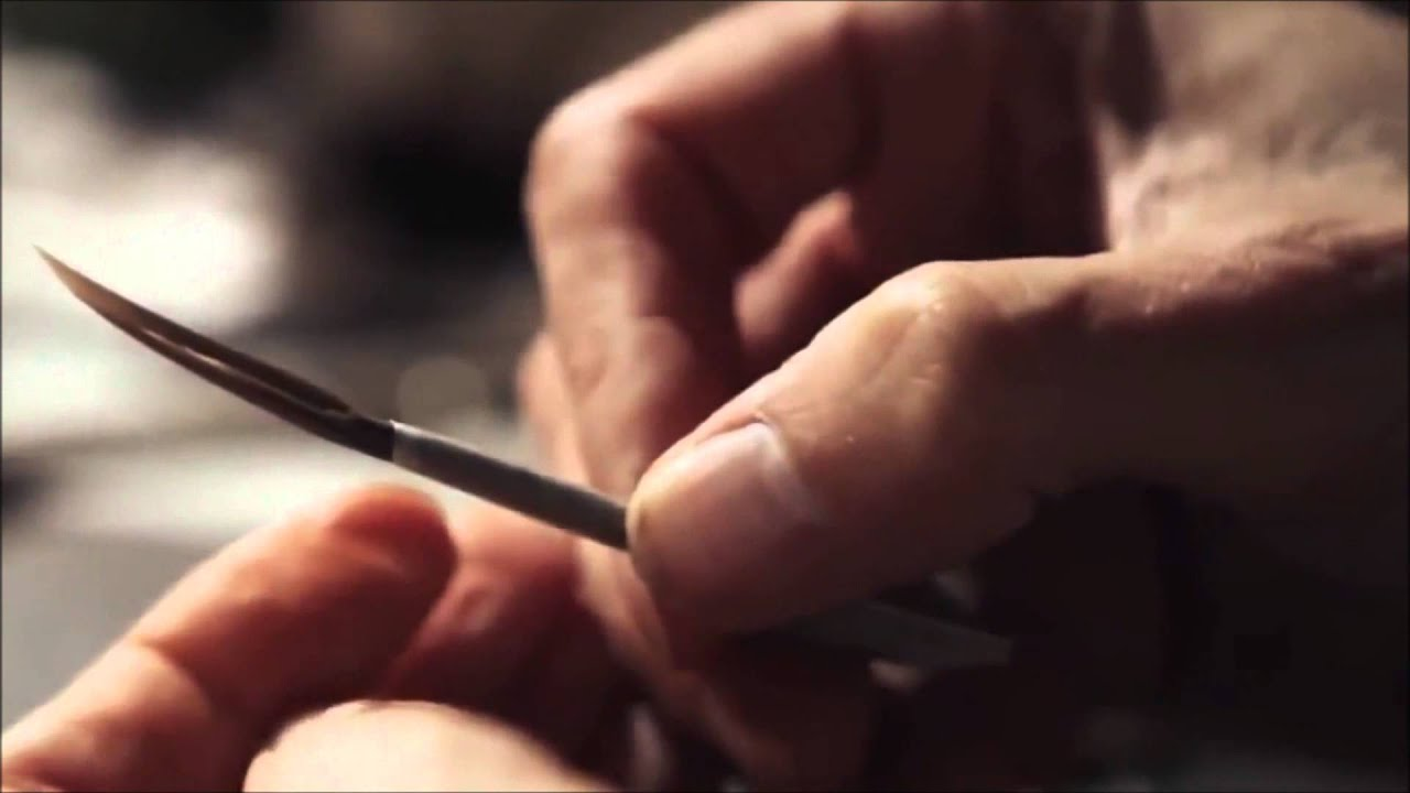Making a paintbrush from a feather.