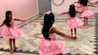 cute kids dance with hula hoop