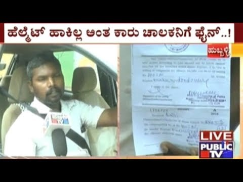 Hubli: Traffic Police Fines A Man For Not Wearing A Helmet While Driving A Car
