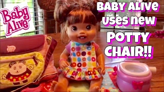 BABY ALIVE uses her new potty chair feeding+potty+playing-2010 Baby Alive New Teeth