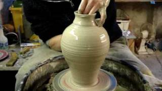 Making Throwing a Pottery Greek Roman Amphora Vase on the wheel
