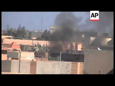 Iraq - Bombing kills 21 at Iraq army recruiting centre / Aftermath of violence which killed at least