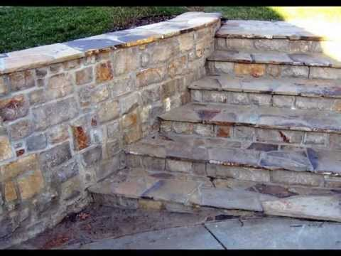 Outdoor Stone Fireplace and Beef Eater BBQ Grill in Custom Stone Surround by Masonry Art, LLC