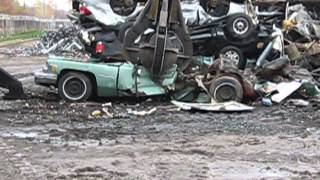 Crushing and Stacking Cars at Omni Source
