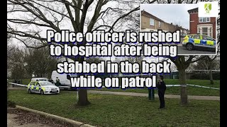 Police officer is rushed to hospital after being stabbed in the back while on patrol