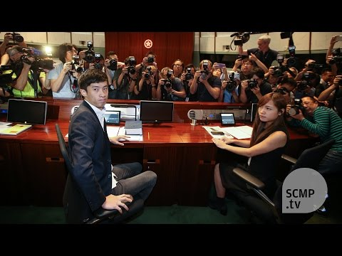 Legco oath-taking crisis continues as meeting adjourned amid chaos