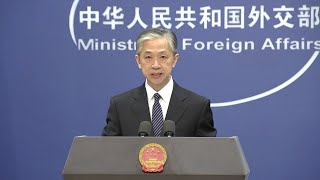 China says it's working with WHO on COVID-19 origin