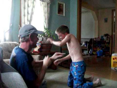 boy annoys dad till he kicks boys butt.