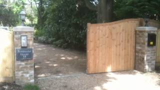 Electric Wooden Sliding Gate Closing By Parkers Fencing