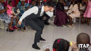 American dances to Macheso's Sungura Music on a wedding