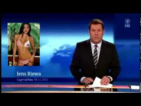 Red faced newsreader caught looking at bikini pictures live on air