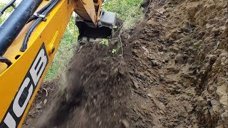 JCB Backhoe-Cutting Stony Hill for New Track-Inside the Cabin