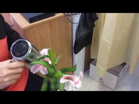Using the hair dryer to make the artificial flowers open