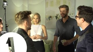 Download Jennifer Lawrence meets Olly Murs. He awkwardly