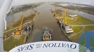 Cruise ship Ovation of the Seas on river: 400m tug boat formation navigating the river Ems