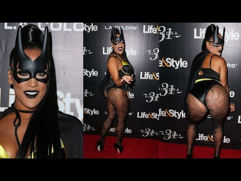 Halloween horror! Reality star Natalie Nunn poses awkwardly on red carpet and SPLITS her costume