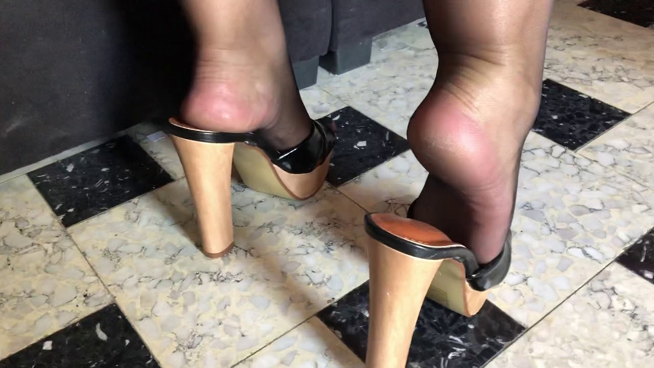 Black pantyhose high heels mule