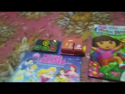 Disney movie theather story book and movie projector and dora explorer music player and story book♡