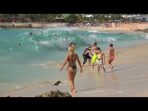 Maho Beach,  St. Maarten. Big waves and Planes. Dec. 10, 2014. 4K