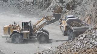 Caterpillar 988H and Dump Truck Caterpillar and Komatsu in action in the quarry
