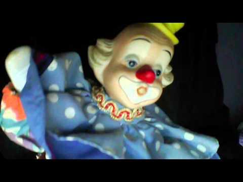 Musical clown doll on a box, Plays Memories