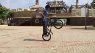 Pravin habib from Team8e doing old school trick on his BMX