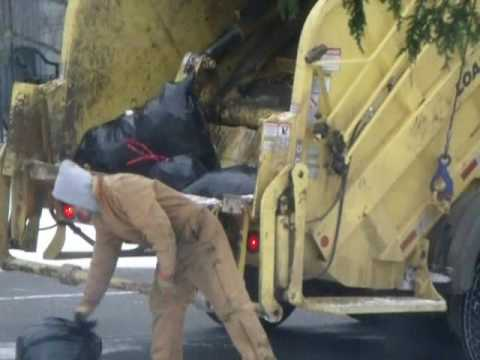 Garbage Truck Packing Full Hopper...