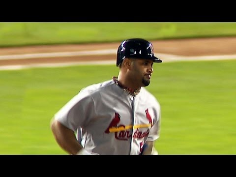 Pujols hits a trio of homers in World Series