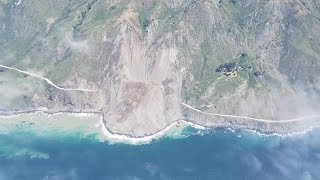 A portion of California's Highway 1 is buried after a massive landslide