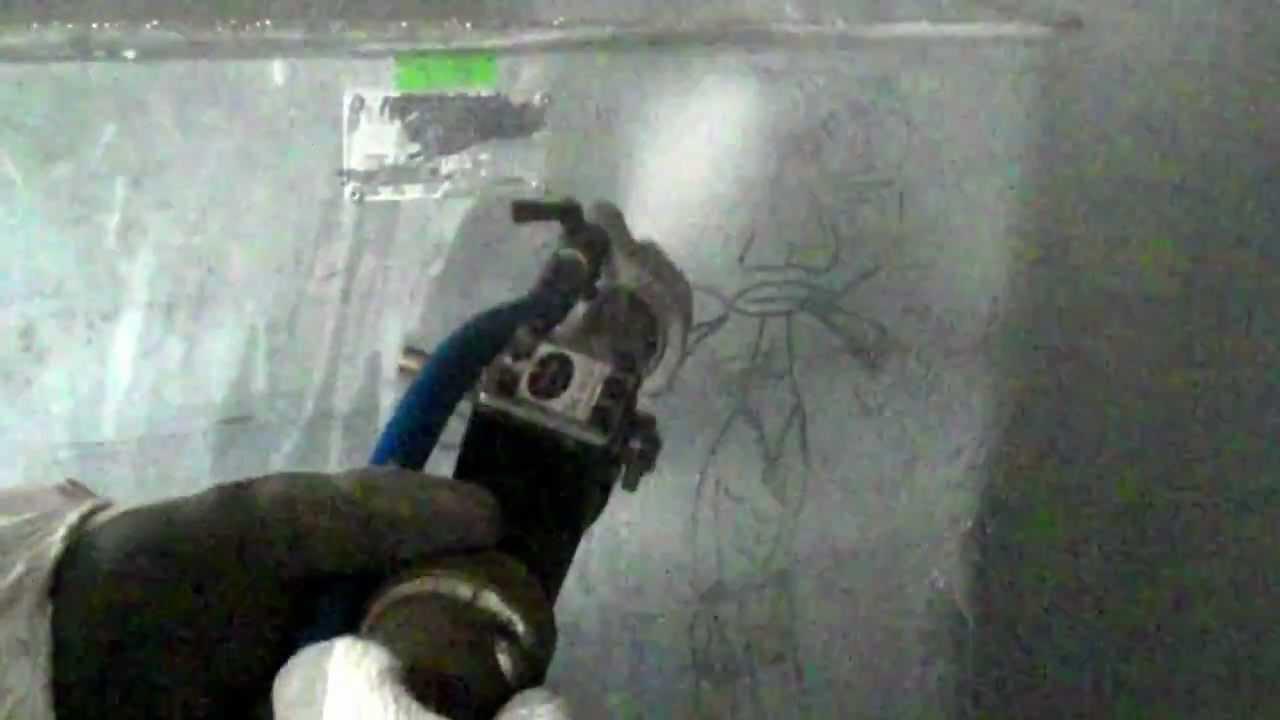Graffiti removal from metal bin using Soda Blast Systems kit