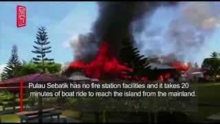 School building on island off Tawau razed