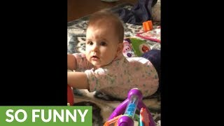 Dad asks baby if she's sick, baby gives hilarious response