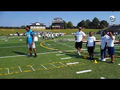 Carolina Panthers linebacker Shaq Thompson walked Mary Bramlett Elementary School students through N