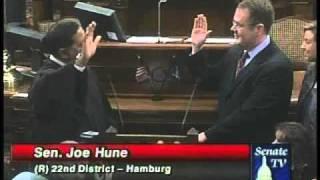 State Sen. Joe Hune, R-Hamburg Twp., is administered the oath of office