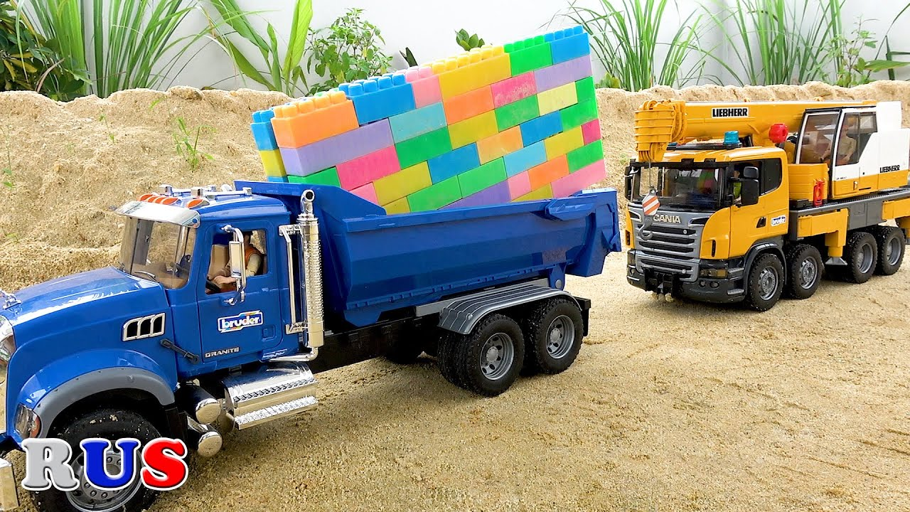 Построить дом грузовик автокран. видео для детей