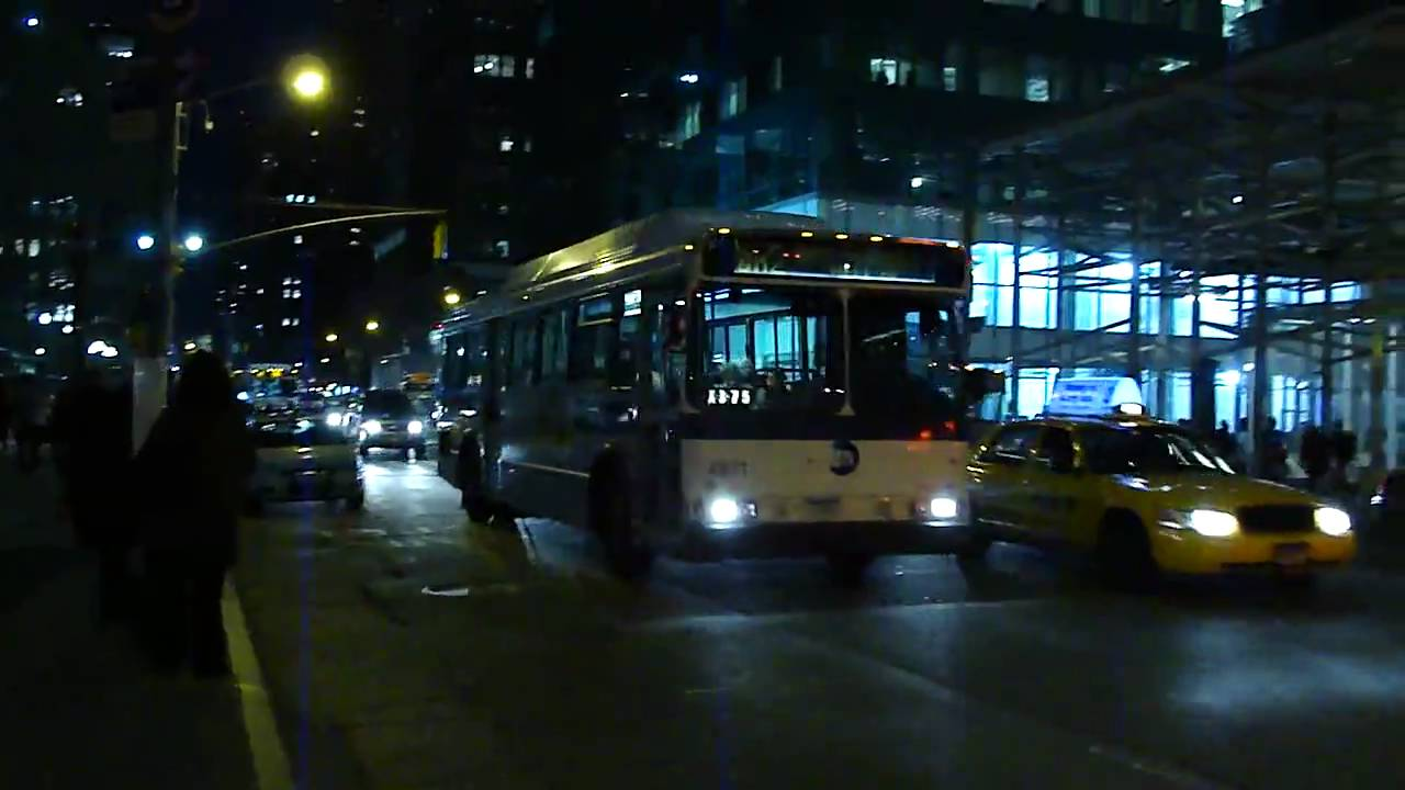 mta bus company 2005 mci d4500cl 3009 & 1998 orion v cng 8571 on the