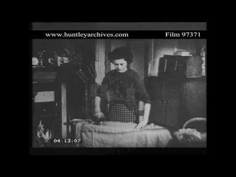 Woman Ironing Whilst Listening to Wireless, 1950's.  Archive film 97371