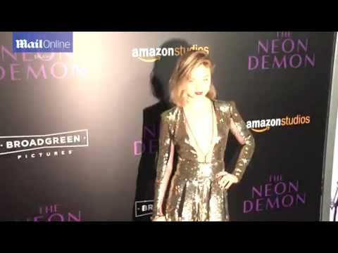 Bella Heathcote smoulders in plunging gold sequin gown at LA premiere of The Neon Demon