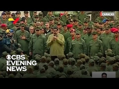 Nicolas Maduro responds to protests with military show of force