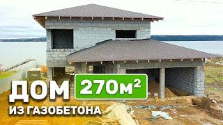 Строительство двухэтажного дома на берегу реки
