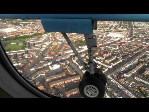 Flybe Dash 8 landing at Belfast City Airport