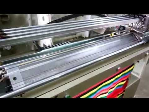 FLAT  KNITTING MACHINE (V -BED)
