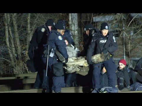 Toronto police remove protesters blocking rail traffic on Milton GO line