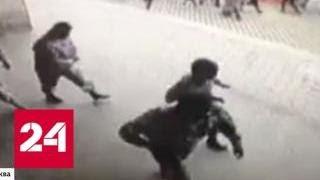 Смотреть видео В Москве ищут банду, которая ограбила банк за две минуты - Россия 24 онлайн