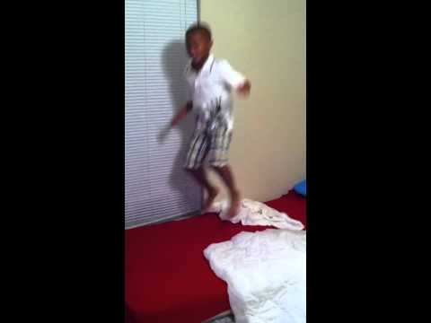 kid falling while jumping on the bed