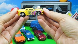 Toy Cars For Children In Large Eggs Surprises. Mack Transporter And Trucks