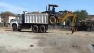 Heavy Equipment Loading Itself