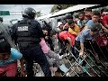 Caravan of migrants held back at Mexico-Guatemala border