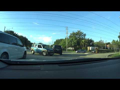 Two panicking idiots driving before Hurricane Irma - Coral springs, FL